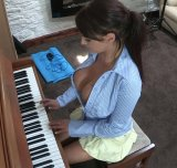 I don't think she knows how to play the piano... oh well :)
