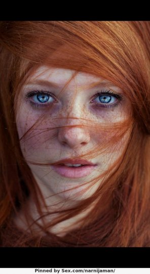 amateur photo Freckles and blue eyes