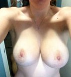 amateur photo Milf posing her Boobs