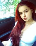 amateur photo Redhead in car