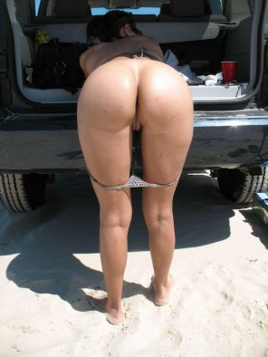 amateur photo Bent over in the back of the van