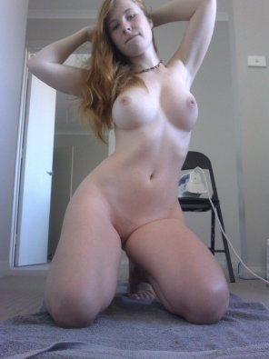 amateur photo Hot pale looking woman got big fake tits and she kneels in front of a mirror to show a fully naked body and her cunt