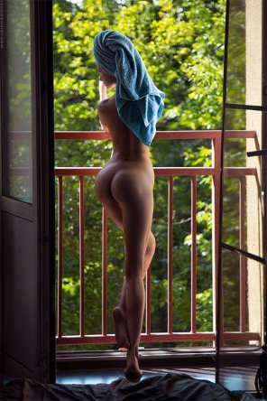 amateur photo Showing on the balcony