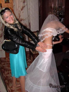 amateur photo Embarrassed bride dealing with an unexpected wardrobe malfunction
