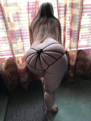 amateur photo Nicely packaged ass by the window