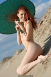 amateur photo Hot redhead in a hot desert
