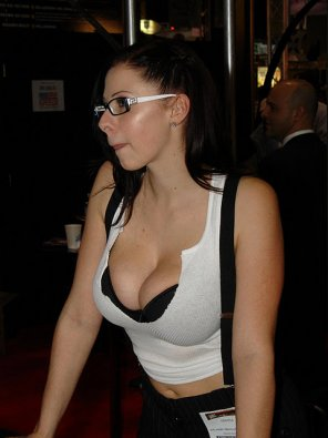 amateur photo Black brassiere under white tank top with large breasts