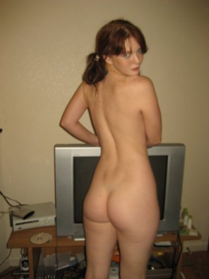 amateur photo In front of her TV