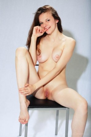 amateur photo Sitting on a stool, showing off her pussy