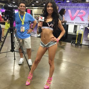 amateur photo Veronica Rodriguez doing a TV interview, wearing very short shorts