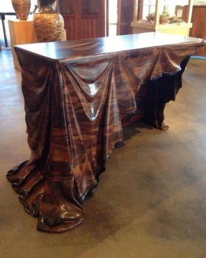 amateur photo Wooden table with wooden cloth carving