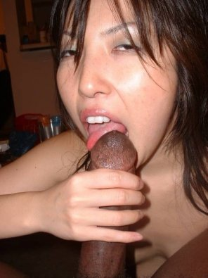 amateur photo licking black dick