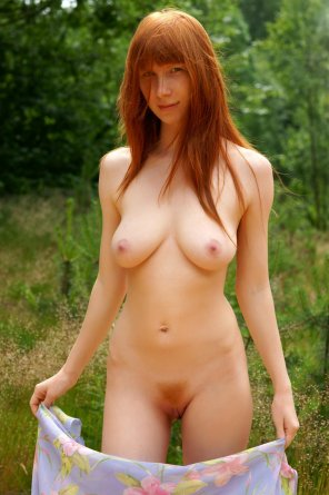 amateur photo Natural redhead posing outdoors