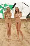 amateur photo two cuties holding umbrellas