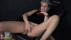 amateur photo Granny with piercing masturbates her pussy