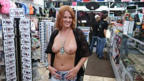 amateur photo Beautiful Redhead at a novelty store