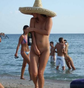 amateur photo Bashful beach babe brings bottle of booze