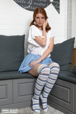 amateur photo Cute redhead in blue striped socks