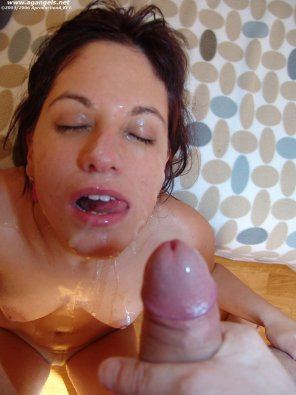 amateur photo Her whole face is covered with sperm