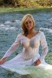 amateur photo Modeling a brides dress in a river.