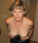 amateur photo Mature woman showing off her tits