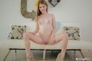 Cute wide eyed teen strips down