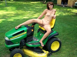 amateur photo Posing naked on the riding mower