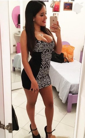 amateur photo Sexy Dress Shows Off Her Boobs