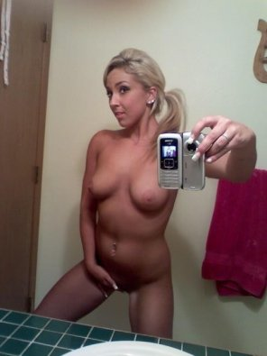 amateur photo Blonde posing for a Selfie.