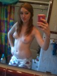 amateur photo cute pale ginger teen topless in front of a mirror