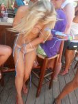 amateur photo Covering up her nearly naked body by the beach bar