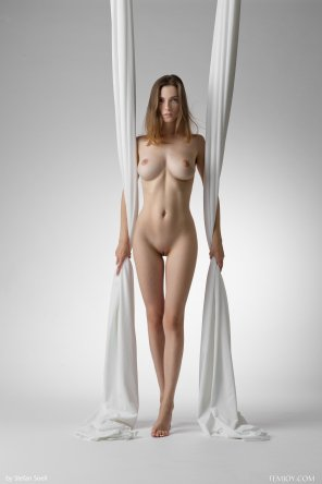 amateur photo Between Two Drapes