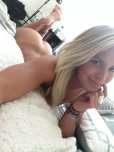 amateur photo blonde girl lying on bed