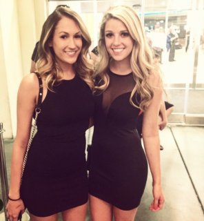 amateur photo Brunette and blonde in little black dresses