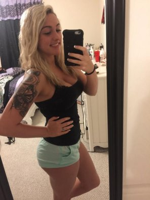 amateur photo Showing off her...tattoo