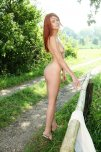 amateur photo Kami Arias - Lovely legs, beautiful eyes, and stunning red hair