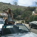 amateur photo Charlotte McKinney in a car...