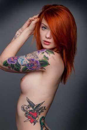 amateur photo red hair and colorful tattoos