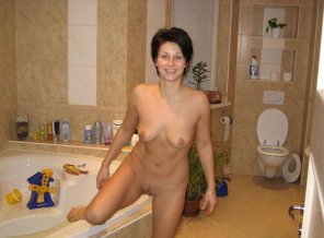 amateur photo She has toys in her bathtub