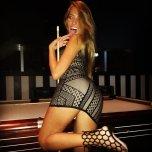 amateur photo Skimpy dress and a pool cue.