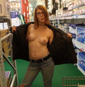 amateur photo Topless in A Store