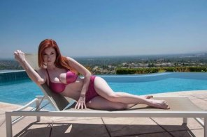 amateur photo Very sexy redhead lounging by the pool