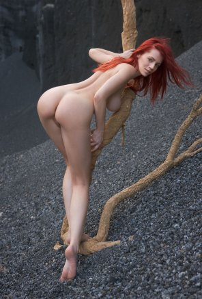 amateur photo Slender redhead bending over