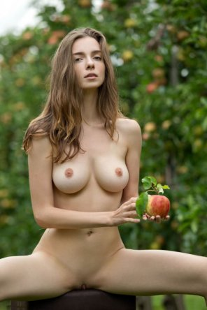 amateur photo Holding an apple