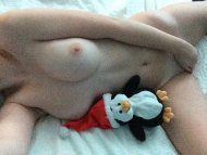Toy Penguin and touching her pussy.