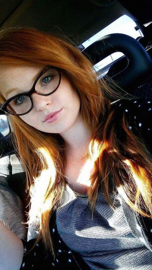 amateur photo Busty redhead with glasses