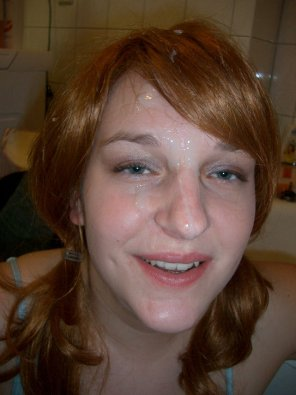 amateur photo Nice ginger with pigtails and a facial