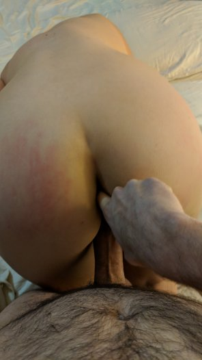 amateur photo After the belt, Master bent me over the bed and used both my holes. [M] [F]