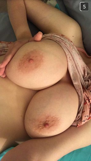amateur photo Showing off her tits. What you think?