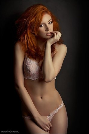 amateur photo Crimson Sexuality. A red head model with huge breasts wearing sensual lingerie.
